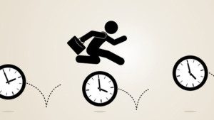 Silhouette of worker holding briefcase leaping over clocks with increasing times