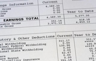 Pay stub showing federal and state withholding