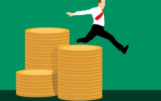 Happy tax payer leaping over stack gold coins